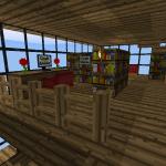 Arbeitsecke mit großer Buchauswahl und Computer mit Crafting Guide